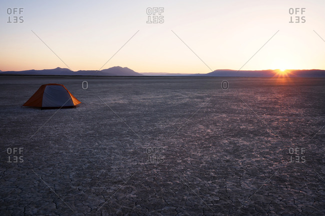 Tent at a campsite on a cracked sand desert