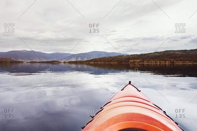 The tip of a kayak on a lake