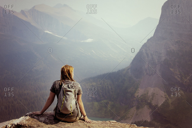 Woman looking at view of Glacier National Park in Montana