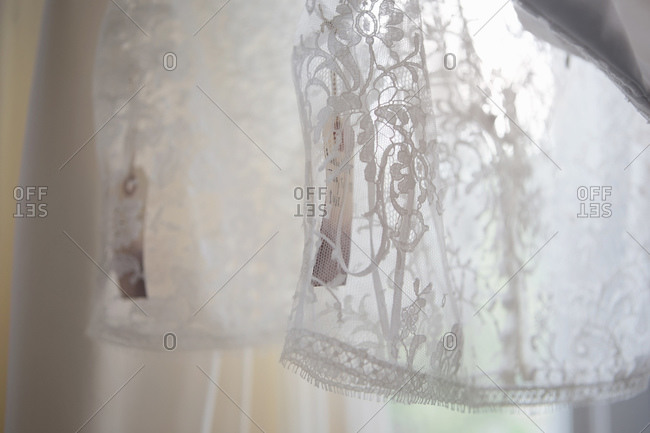 Close-up of lace apparel with tags attached