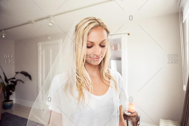 Woman in boutique tries on wedding veil