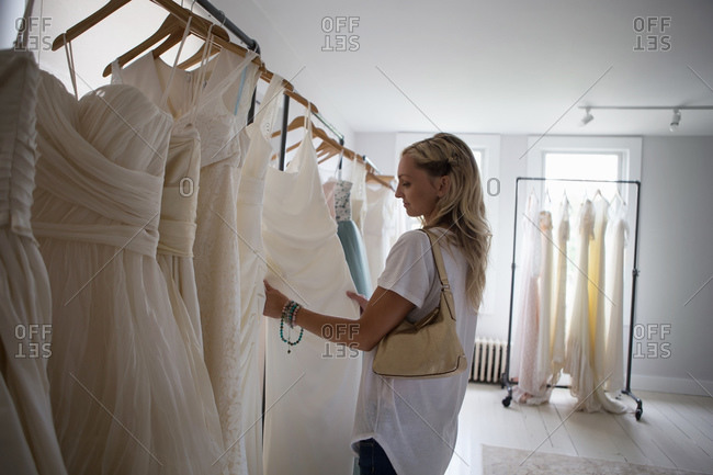 Woman shopping for a wedding gown in a bridal studio