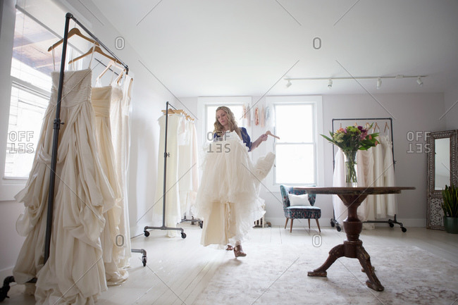 Wedding gown designer examines her work