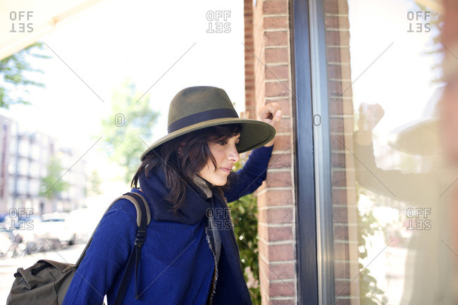 Young woman gazing into a store window