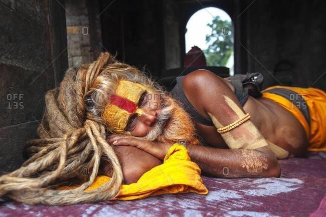 Kathmandu, Nepal - September 1, 2013: A holy man in the Pashupatinath Temple in Kathmandu, Nepal