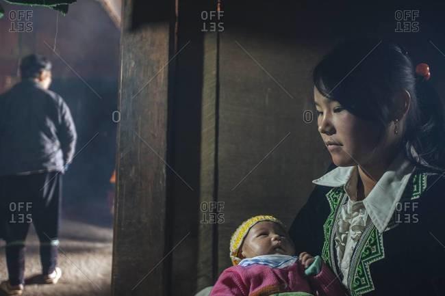 Sapa, Vietnam - January 27, 2014: A Vietnamese woman holding her child