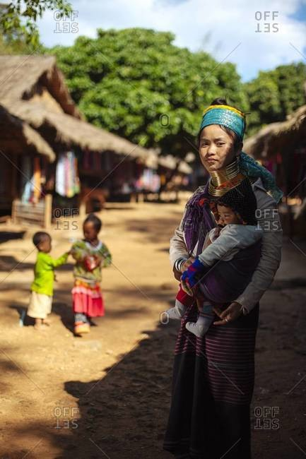 Chiang Mai, Thailand - December 20, 2013: A woman holding her baby in the city of Chiang Mai in northern Thailand