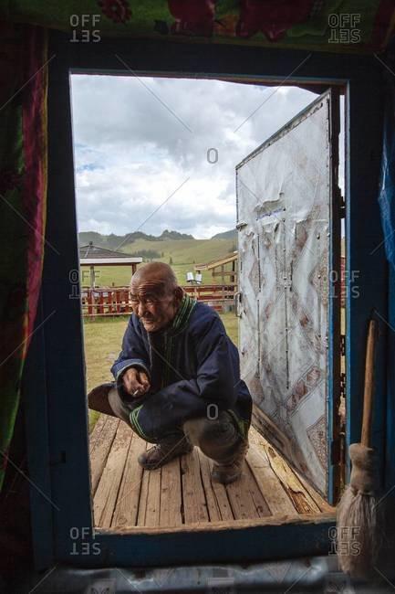Ulaan Baatar, Mongolia - July 8, 2013: Mongolian elder from his Ger in the outskirts on Ulaan Baatar
