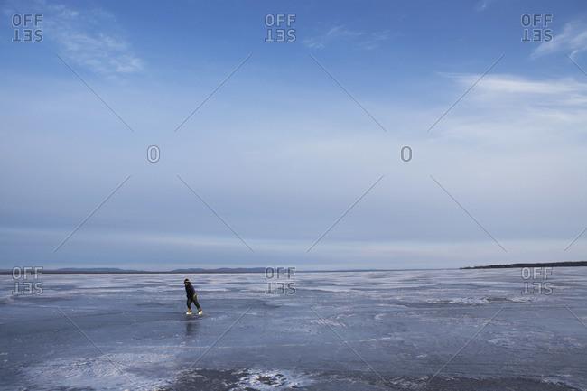 Boy Skating on Frozen Lake