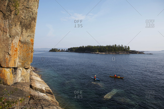 People kayaking on Lake Superior, Ontario, Canada