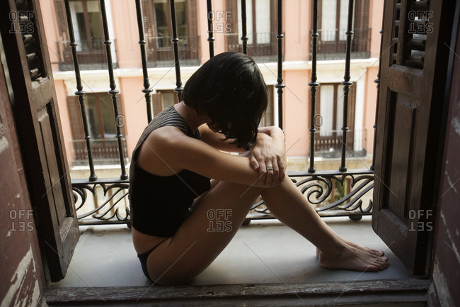 Woman in Lingerie, Sitting on Balcony