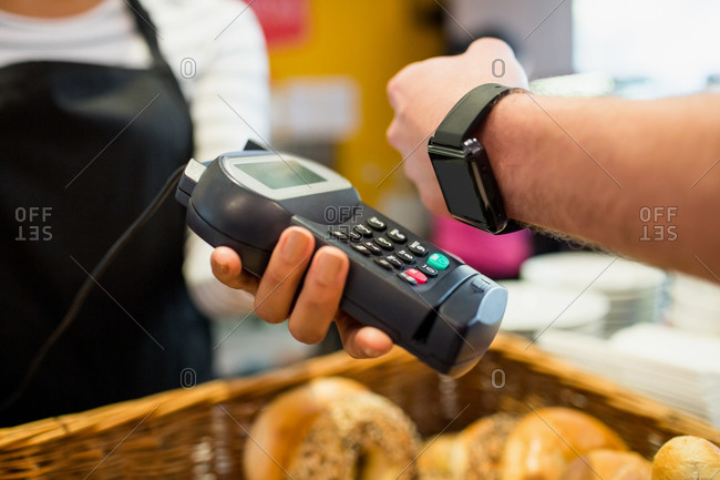 Customer paying with smart watch at the cafe