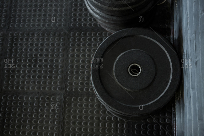 Above view of weights on the floor of a fitness center