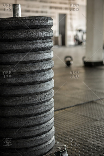 Weights stacked on the floor of a fitness studio