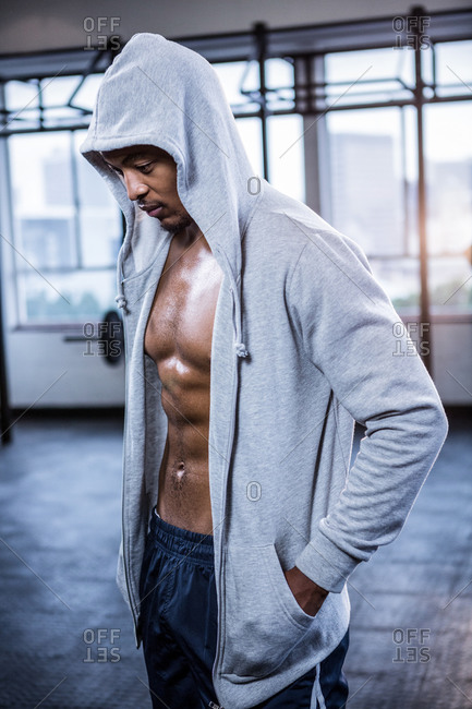 Man wearing hooded sweater at the gym