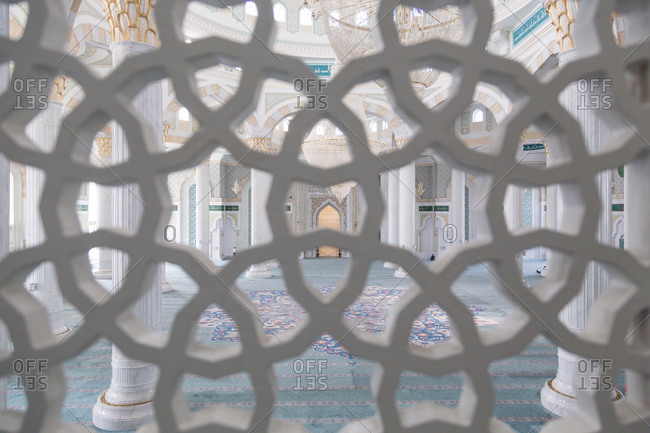 Astana, Kazakhstan - July 19, 2015: Interior of mosque through screen