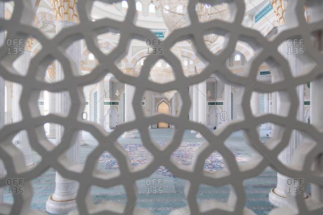 Astana, Kazakhstan - July 19, 2015: Interior of mosque through screen