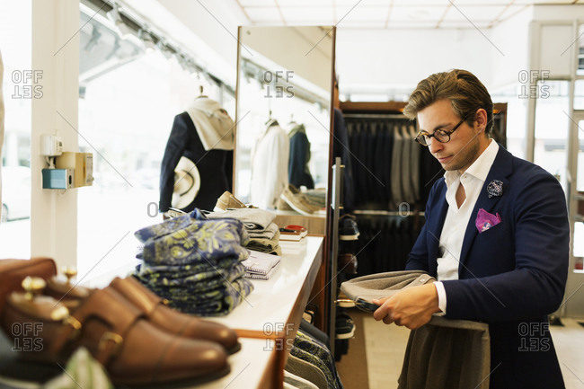 Man looking at suit coat in a shop