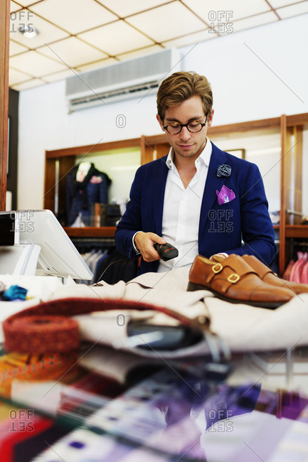 Man ringing up purchases in men's store