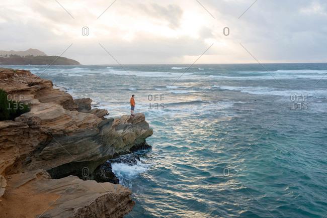 Watching the sunrise along the coast of Kauai, Hawaii