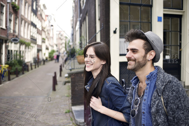 Cool couple walking in quaint city street