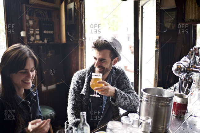 Couple chatting over drinks in bar