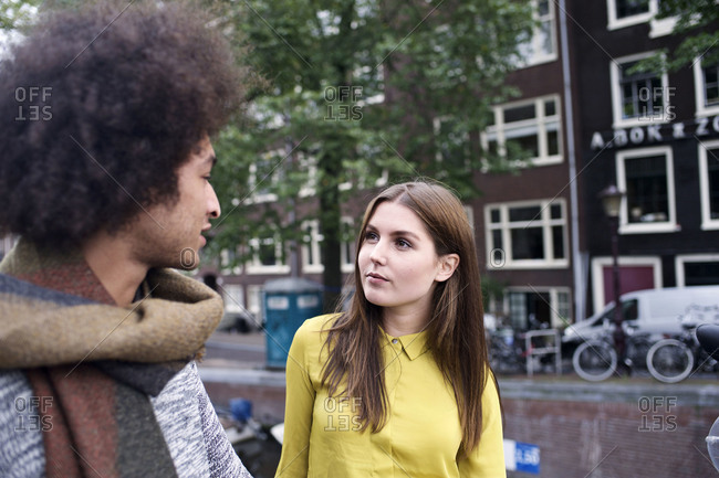 Man and woman chatting on street in Amsterdam