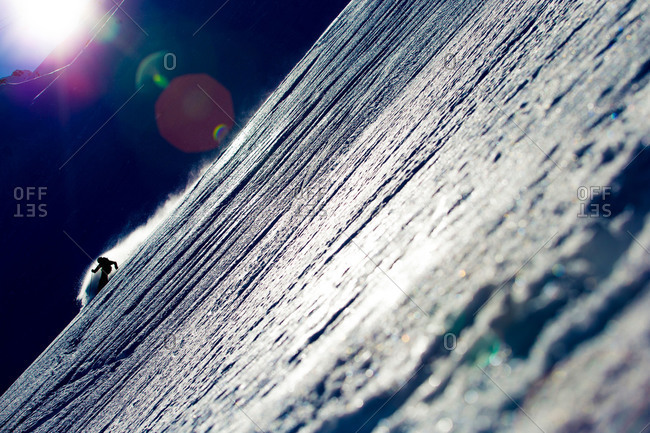 Off-piste skier in sunlight