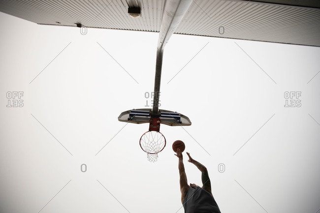 Man midair dunking basketball - from the Offset Collection