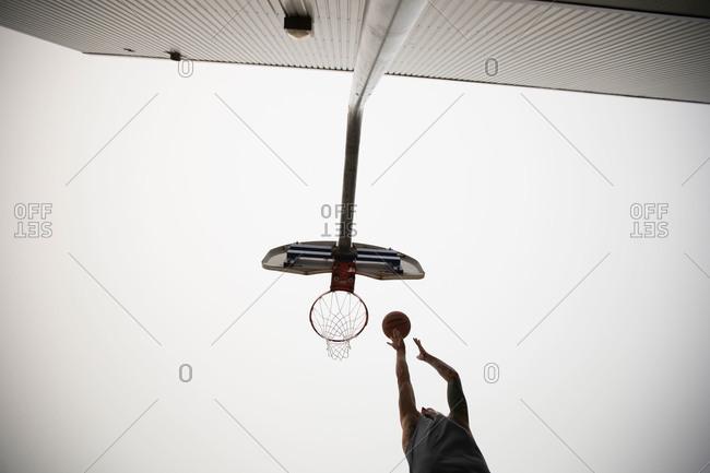 Man midair dunking basketball