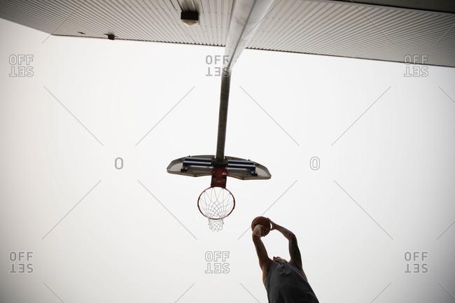 Man midair dunking a basketball