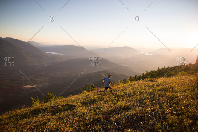 Man jogging up hill in remote mountain setting