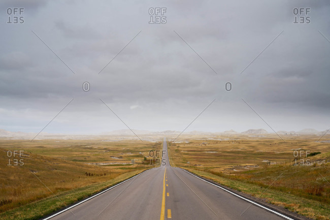 A long road through a brown landscape