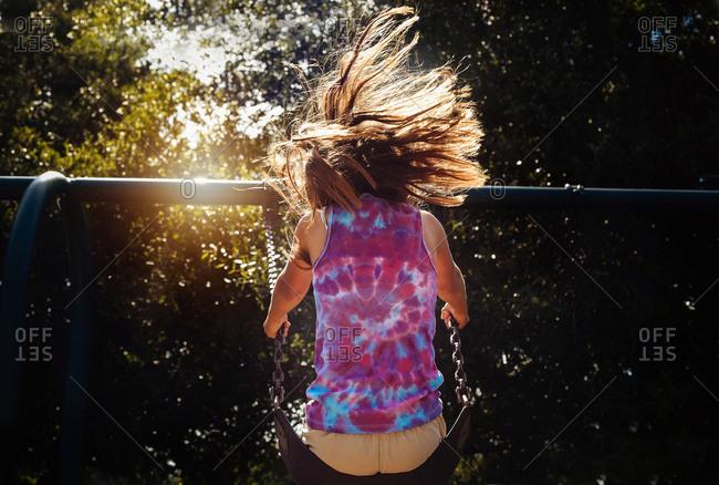Girl on a playground swing set