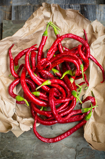 Red cayenne chilies on brown paper