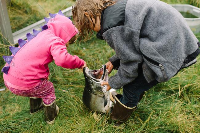 Girls examining at a big fish they caught