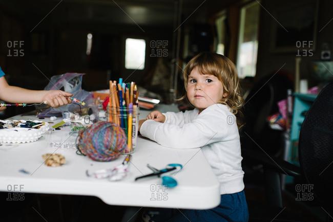 Children making bead crafts