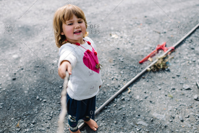 Girl playing with a stick
