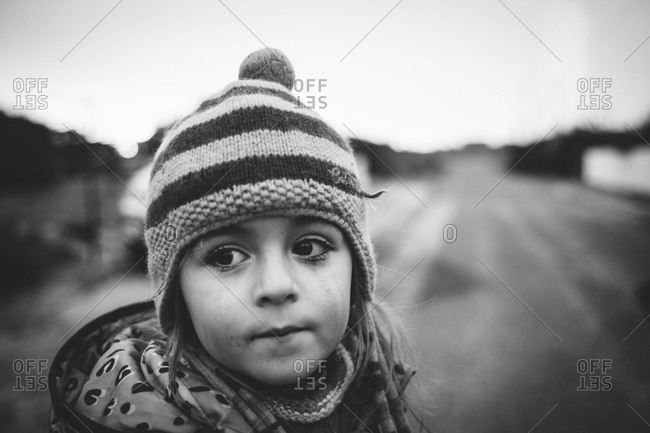 Portrait of a little girl in a knit hat
