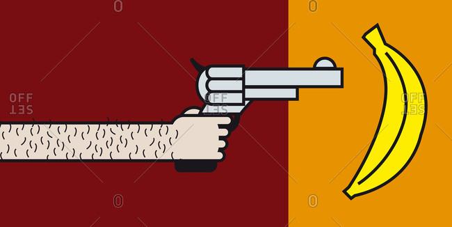Man pointing a gun at a banana