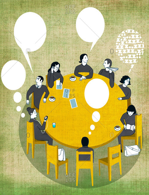 Uninterested team sitting around table in a meeting