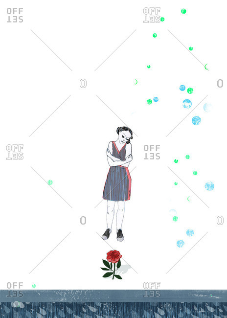 Woman standing in front of red rose
