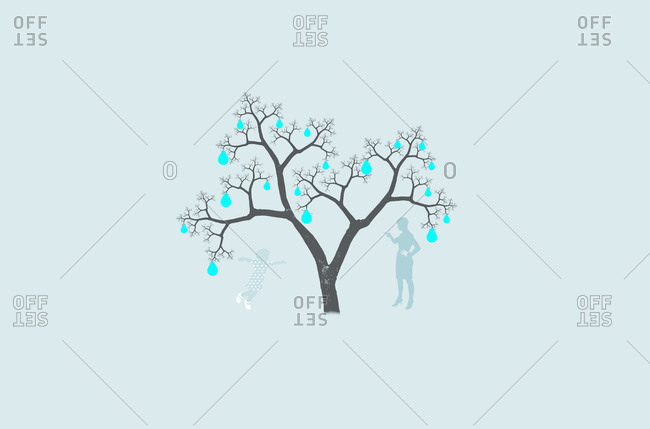 Mother and daughter underneath tree with light bulbs