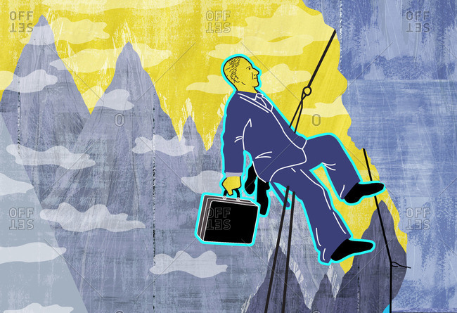 Businessman climbs to the top of mountain