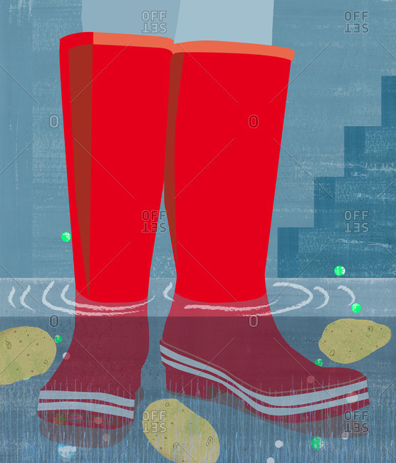 Red rain boots in flood