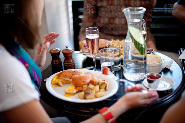 A woman eats brunch in a restaurant
