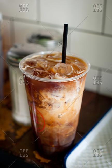 An iced coffee with cream