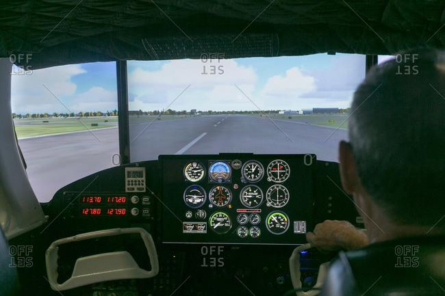 Pilot in a flight simulator console