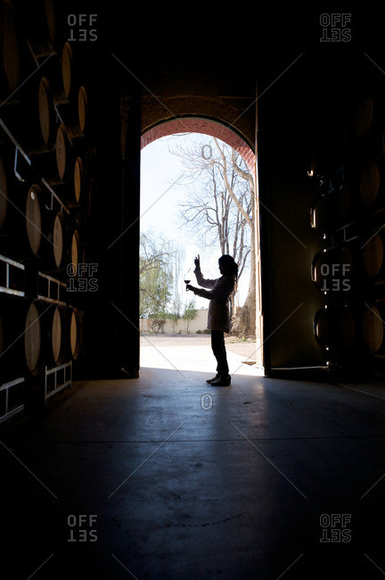 A woman tests wine at an Argentinian winery