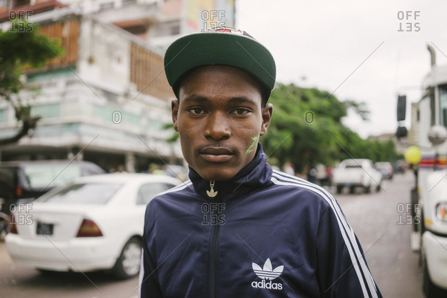 Maputo, Mozambique - March 28, 2015: A young man on the street after school